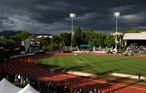 The sun emerges as 200-meter racers round the curve at Hayward Field during the second day of the NCAA Track and Field Championships at Hayward Field in Eugene, Oregon.
