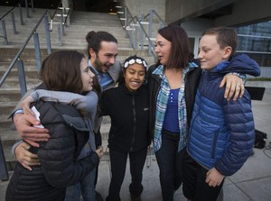 In November 2016, five of the 21 youth plaintiffs in a federal climate change lawsuit against the federal government, including from left Sahara Valentine, 11, Avery McRae (not visible), 10, Jacob Lebel, 19, Miko Vergun, 15, Kelsey Julianna, 20, and Zealand Bell, 11, hug on the steps the Wayne Morse U.S. Courthouse in Eugene after U.S. District Judge Ann Aiken rejected requests from the federal government and trade groups representing many of the world's largest energy companies to dismiss their lawsuit.