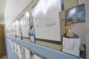 Student college projects line the hallways at Sherwood Heights Elementary School in Pendleton.