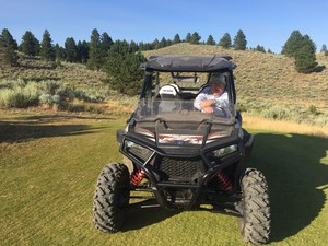"""Silvies Valley Ranch owner Scott Campbell on one of three golf courses at the ranch. Campbell says it's the second reversible course in the world and includes many """"green"""" features."""