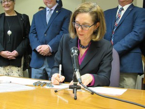 Oregon Governor Kate Brown signs a drought emergency declaration in Klamath Falls on Tuesday, March 13, 2018.