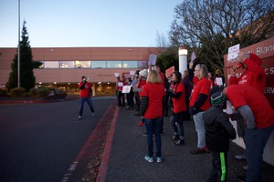 Staff and parents from Pioneer Special School protest outside the Portland Public Schools administration building, Dec. 5, 2017.