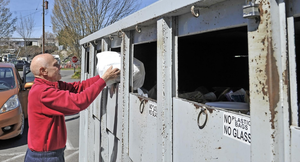 David Duarte of Talent, Oregon, recycles at the Ashland Recycling Center on Wednesday, March 28, 2018.