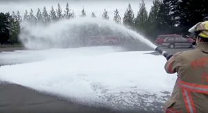 Portland firefighters spray foam at a training site in Northeast Portland as a demonstration in 2014. This foam is crucial for fighting intense fires like those from an airplane or oil train. But it also contains harmful chemicals that have seeped into groundwater.