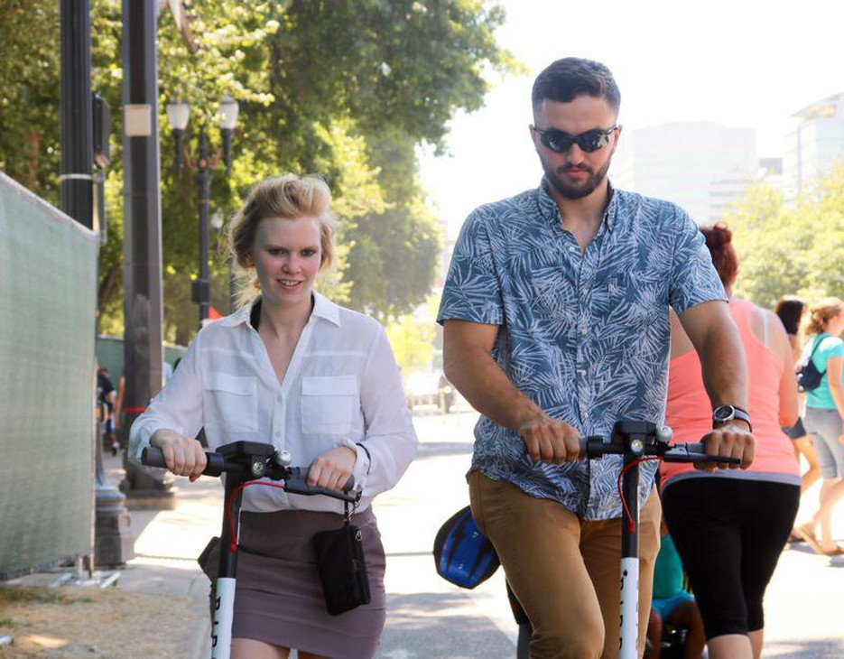 "Sam Kane and Caitlin Drost say Bird brand electric scooters are ""super fun"" and ""pretty awesome,"" respectively."