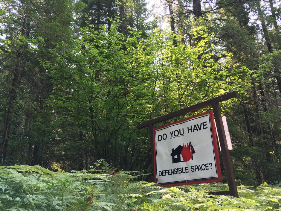 "A roadside reminder in southwest Washington's Gifford Pinchot National Forest that homes in the ""wildlands urban interface"" need special landscaping, building materials and maintenance to reduce the risk of being destroyed by a wildfire."