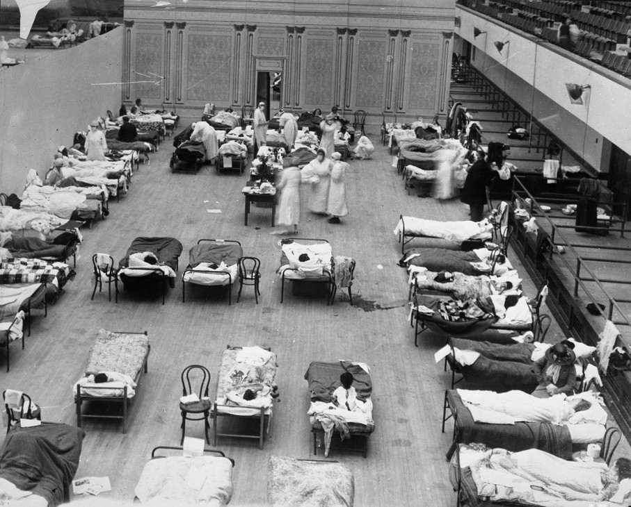 Make-shift hospitals were set up in Portland, and other cities.  Here volunteer nurses from the American Red Cross tend influenza sufferers in the Oakland Auditorium, in California.