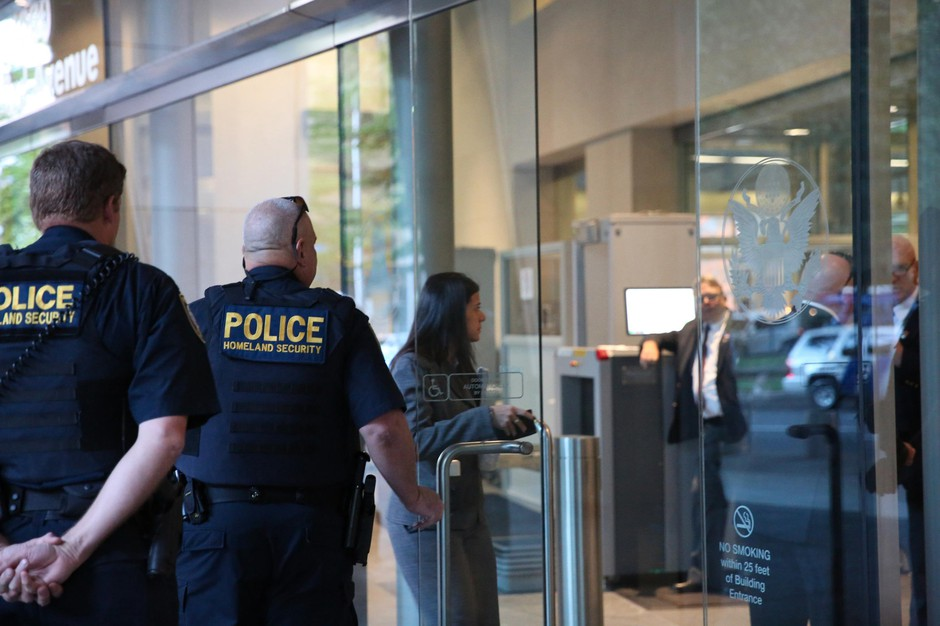 In this Sept. 13, 2016, file photo, people enter the Mark O. HatfieldUnited States Courthouse in Portland, Ore. Law enforcement officials in Oregon say they've uncovered an elaborate scheme to circumvent Chinese banking laws.