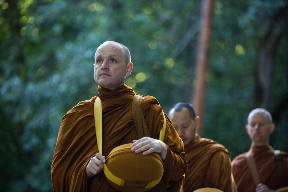 From left, Ajahn Sudanto, Ajahn Kassapo and Tan Sampanno begin their morning alms round through White Salmon.