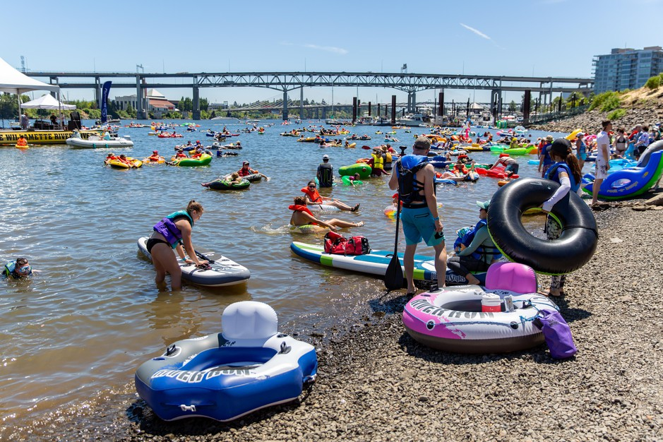 Hundreds of people came to Tom McCall Waterfront Park in downtown Portland to participate in the Big Float, an annual event that aims to raise support for Willamette River preservation.