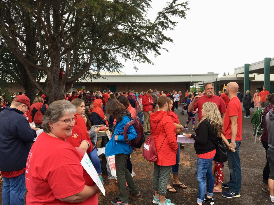 School teachers and community members spilled into the courtyard at the Battle Ground Public Schools board meeting Monday night after the room filled to capacity.