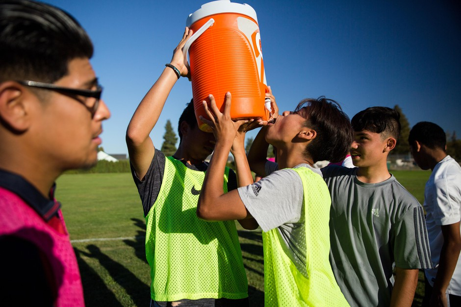 Jonathan Martinez drinks from the water cooler at McKay's boys soccer practice.