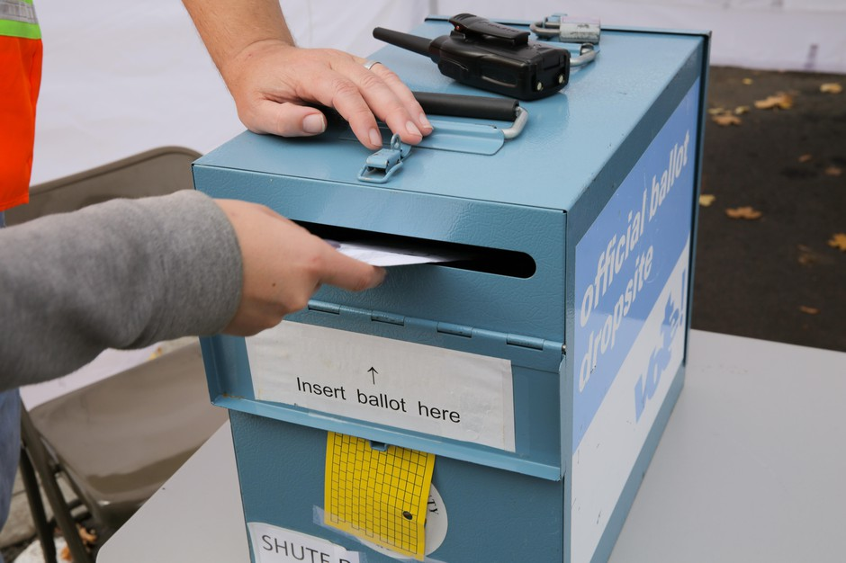 A ballot is dropped off at the Washington County Elections Office in Beaverton, Ore. on Nov. 5, 2018.
