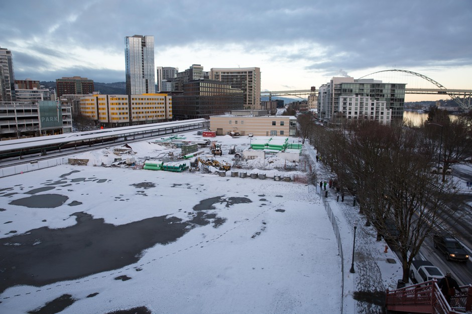 Snow blankets the site of the future Harbor of Hope homeless center in Northwest Portland, Ore., Tuesday, Feb. 5, 2019.