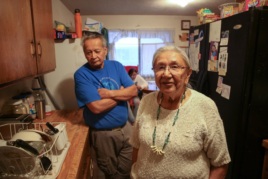 Arlita Rhoan, right, and Lyle Rhoan stand in their kitchen on the Warm Springs Reservation on Thursday, March 28, 2019, in Warm Springs, Ore.
