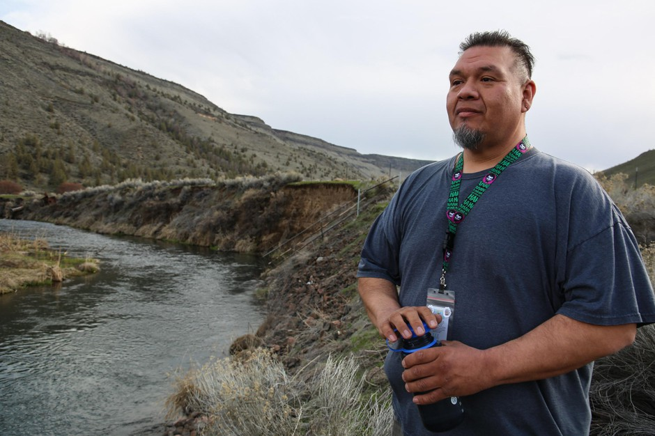 Warm Springs water treatment plant engineer Ron Palmer stands by the ox bow, a side channel dug into the Deschutes River, where surface water is collected for treatment on Friday, March 29, 2019, in Warm Springs, Ore.