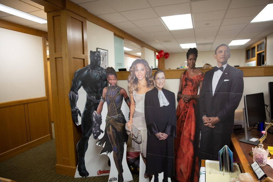 Powerful figures stand at the entry into Rep. Janelle Bynum's statehouse office in Salem, Ore.