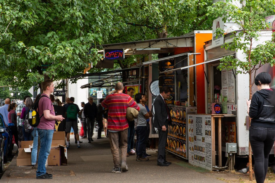 Customers line up in front of food carts on Southwest Alder Street in downtown Portland. The pods must vacate the space by June 30, 2019.