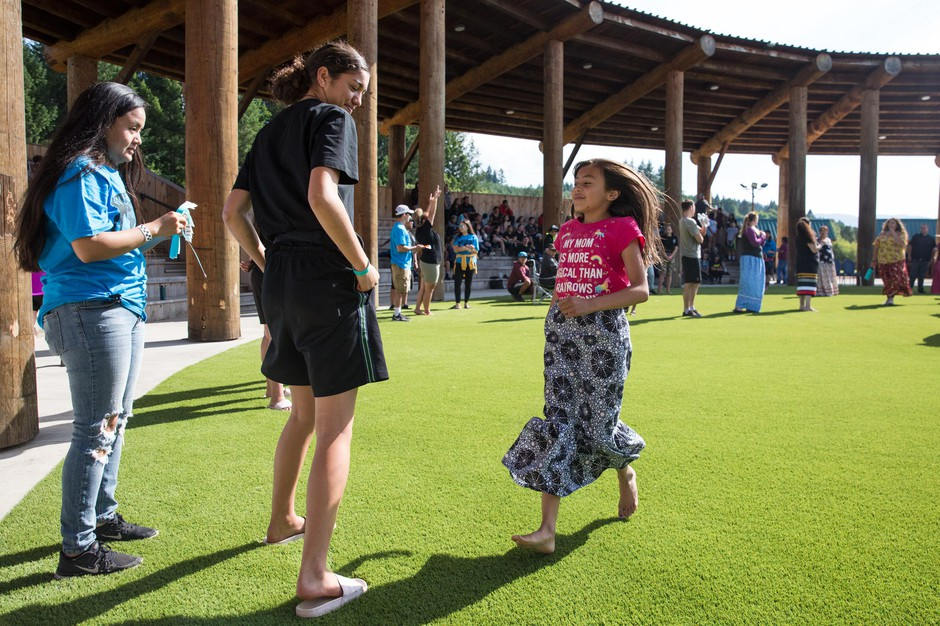 A girl runs to meet her group at Wellness Warrior Camp in Grand Ronde, Ore., Monday, June 24, 2019. Native Wellness Institute canceled 2020's in-person camp due to COVID-19.
