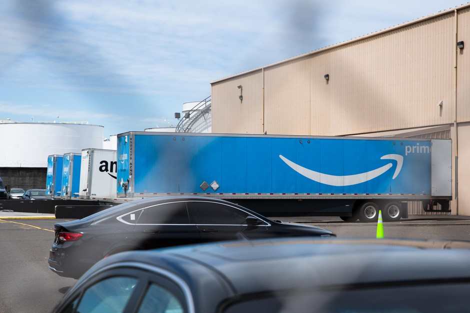 Trucks sit at the loading docks of the Amazon delivery station in northwest Portland, Ore., Friday, July 12, 2019.