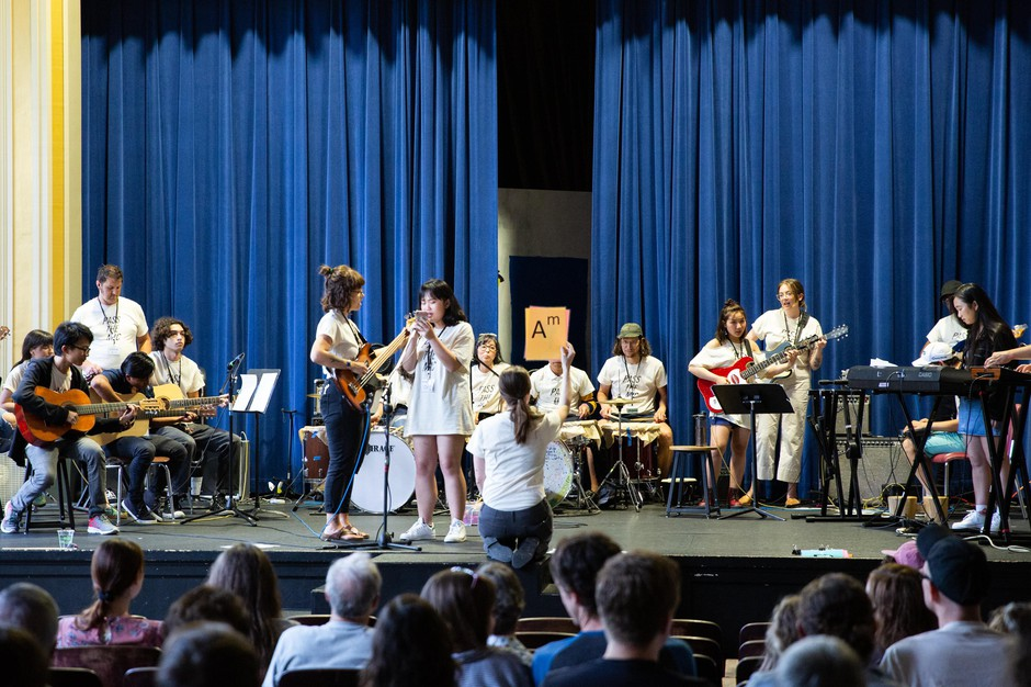Students and mentors gather onstage to perform for the Pass the Mic showcase in the auditorium of Hosford Middle School in Portland, Ore., Friday, Aug. 2, 2019.