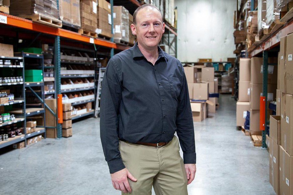 """Dave Stainsby stands in Made in Oregon's warehouse in Portland, Ore., Wednesday, July 24, 2019. Stainsby says sales tax collection has changed """"night and day."""""""