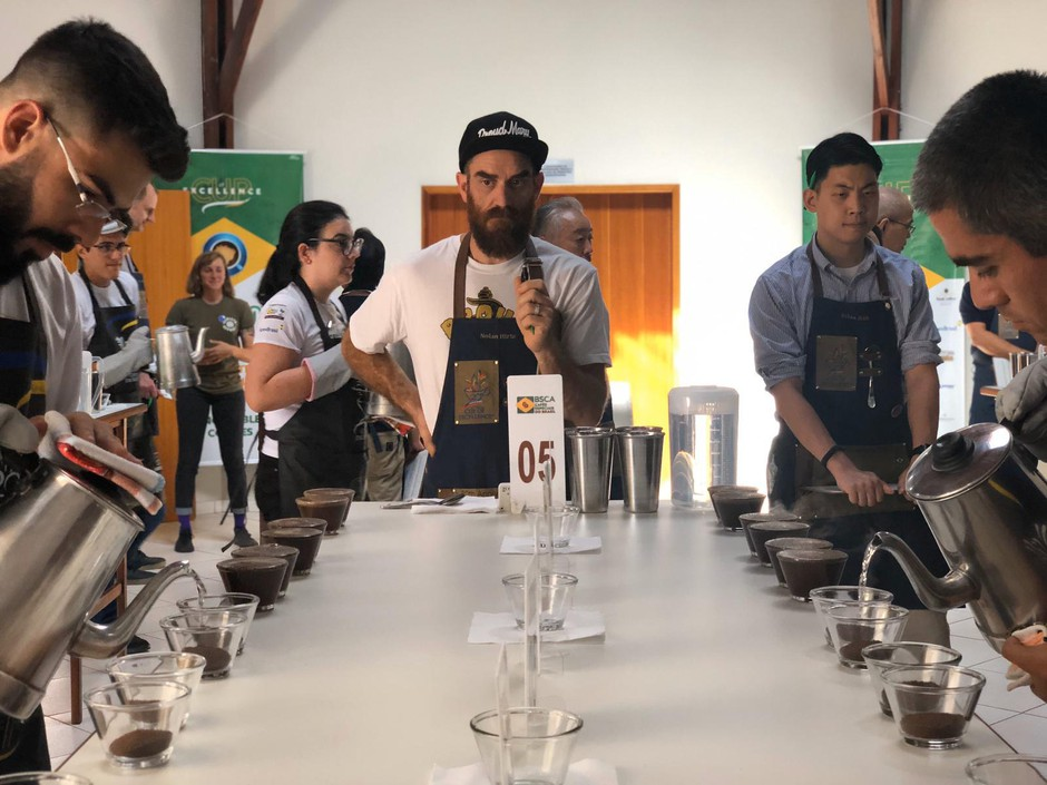 Cup of Excellence judge, NolanHirte, evaluating coffees.