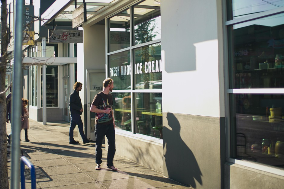 Customers visit Salt & Straw ice cream store in Alberta Street for take-out pints only, March 21, 2020. The popular chain announced it would close until further notice due to the novel coronavirus pandemic.