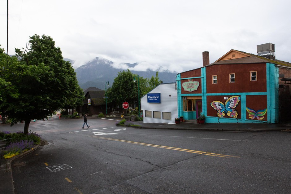 A man walks through downtown Stevenson, Wash., Thursday, May 14, 2020. Skamania County was one of the first counties in Washington to partially reopen amid the COVID-19 pandemic.