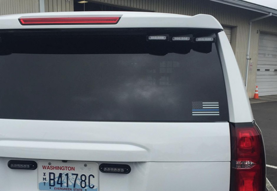 A black-and-white flag with a blue bar at its center is affixed to a Clark County Sheriff's Office SUV. Global protests against police brutality have renewed criticism of the symbol.