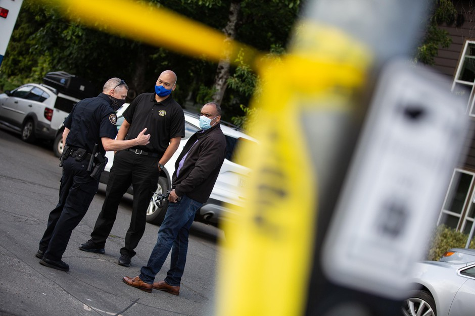 Police Chief Chuck Lovell, right, was among those responding to a person believed to be armed inside a vacant home in the Sellwood neighborhood of Portland, Ore., Sunday, June 28, 2020. One officer fired their weapon and the subject was not injured.
