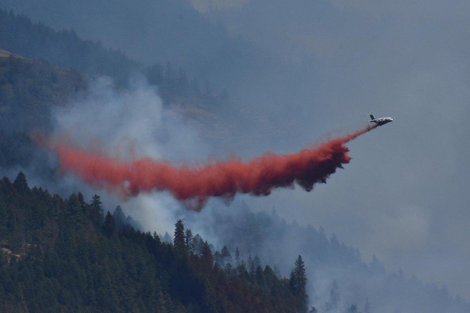 An air tanker makes a retardant drop on the South Umpqua Complex fires.