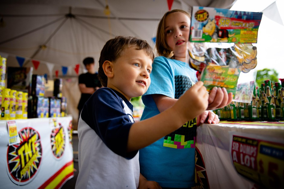 Sophie (right) and Zach Plummer-McGraw look at fireworks at the TNT Fireworks stand in Beaverton, Ore., Wednesday, July 3, 2019.
