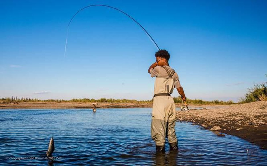 Tara Cooper's son Andre Tharp fly fishing in the Arctic Circle in the Venati Village and immersion with the Gwich'in Nation as part of Soul River's deployment in the summer of 2018.