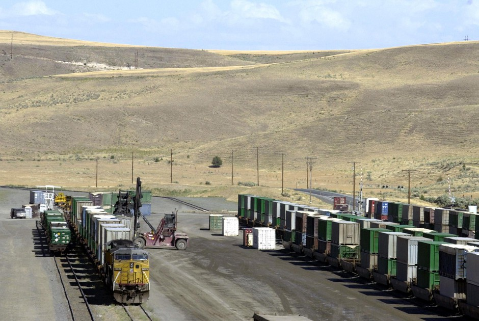 Garbage, hauled in by train from long distances, is unloaded onto trucks for transfer to the landfill in the barren, rolling hills near Arlington, Ore., Aug. 3, 2004.