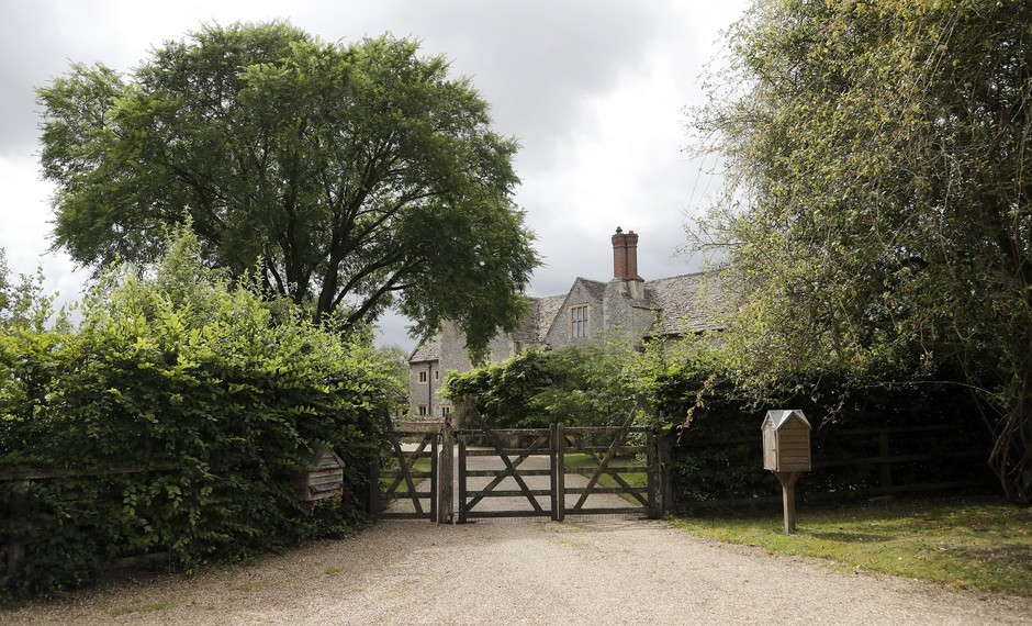 A gate closes off a side entrance of the Rooksnest estate near Lambourn, England, Tuesday, Aug. 6, 2019. The property belongs to the Sackler family, owners of Purdue Pharma based in Stamford, Conn. A complex web of companies and trusts are controlled by the family, and an examination reveals links between far-flung holdings, far removed from the opioid manufacturer's headquarters in the U.S.