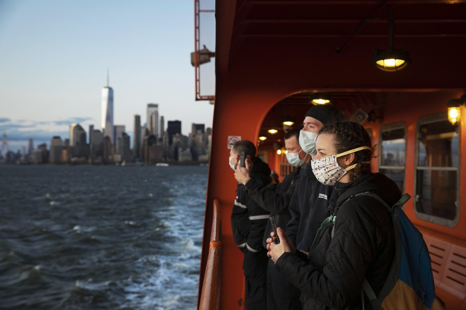 A group of emergency medical technicians who have come to New York to assist ambulance crews during the coronavirus pandemic ride the Staten Island Ferry, Tuesday, April 21, 2020, in New York.