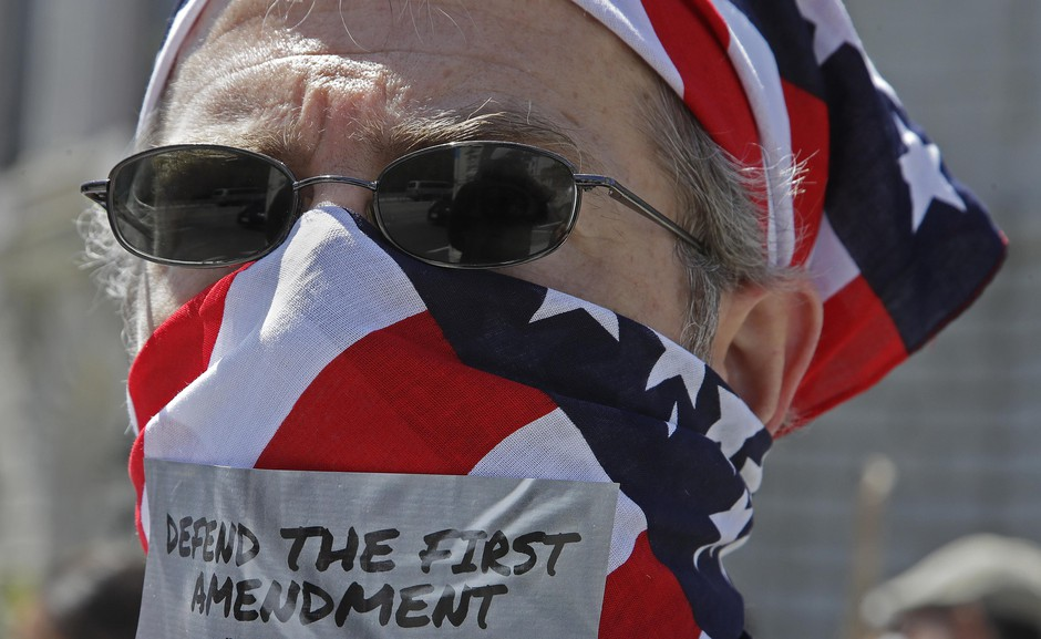 A protester in favor of reopening California to business marches at City Hall on Friday, May 1, 2020, in San Francisco. After similar rallies around the country, small groups of Oregonians will demonstrate in Salem and Burns.