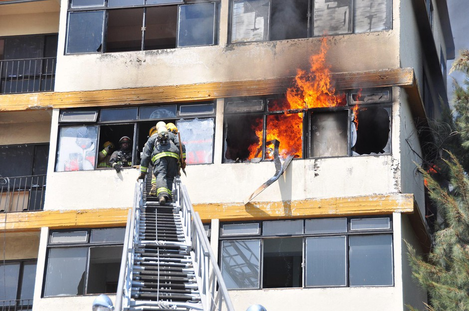 Firefighters participate in a high-rise firefighting training in Latin America in 2012.
