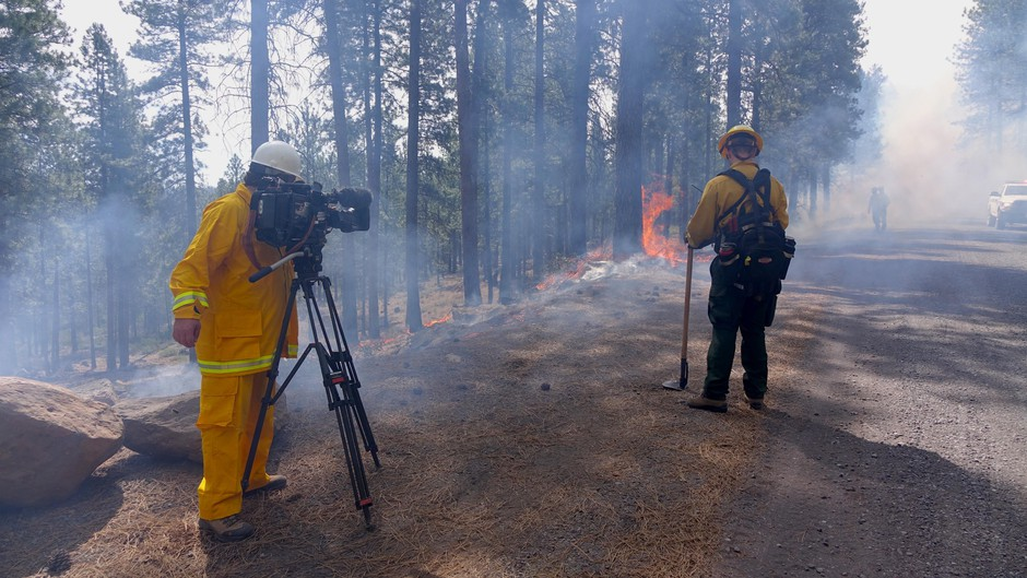 OPB Senior Videographer Nick Fisher filming a prescribed burn in spring 2018.