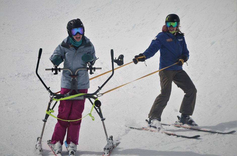"""Using a """"slider"""" helps Dana Sherry carve her own turns as she and her instructor Kellie Standish ski the half-pipe at Mt Bachelor."""