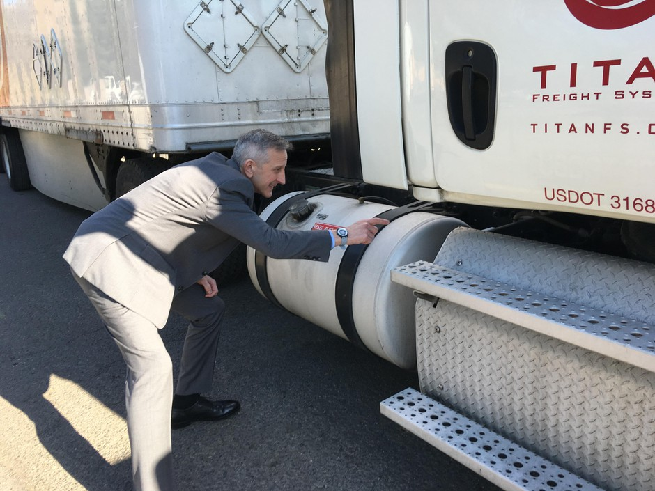 Keith Wilson, president of Titan Freight, points out fuel-efficiency features on one of his company's trucks on Feb. 21, 2020.