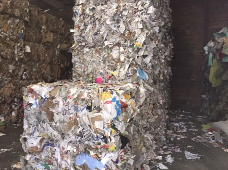 Recycled paper is baled for sale at Far West Recycling in Portland, Ore.