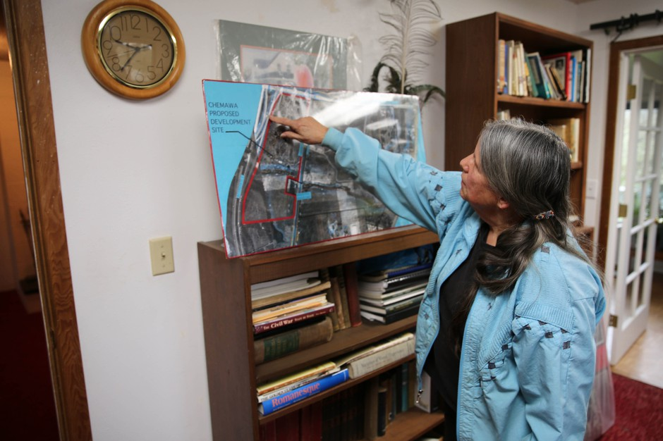 SuAnn Reddick points to locations on a historic map of the Chemawa Indian School campus.