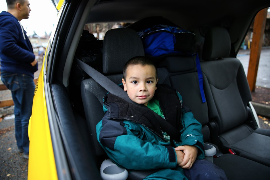Michael Bunch, 4, sits in a car on what was moving day for his family. Until then, Michael had never had a home of his own.