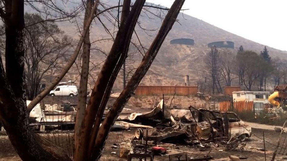 One of the hardest hit neighborhoods in the Pateros included the one at the bottom of this hill below water storage tanks, where the fire raced down the hill from the north where it started near the town of Carlton.