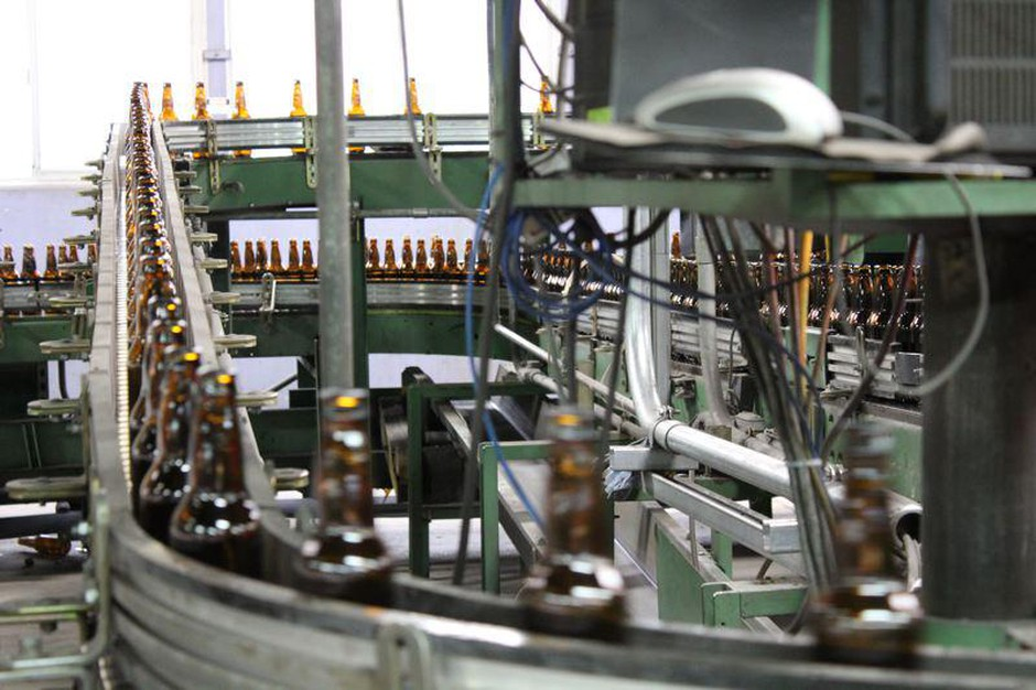 Reusable beer bottles for a new statewide program are being made at Owens-Illinois Glass Plant in Portland.
