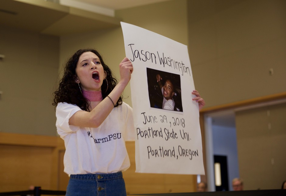 """Juli Castro, a senior at PSU, chants """"say their names"""" at a special Board of Trustees meeting regarding campus public safety polices at Portland State March 7, 2018."""