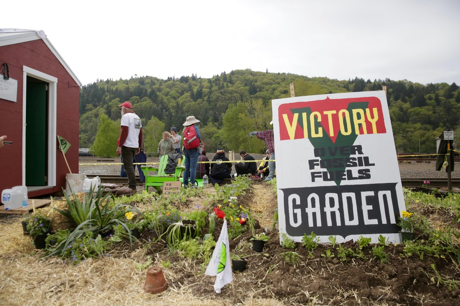 A small garden and house were built at the site of Zenith Energy in Northwest Portland to protest the expansion of its petroleum terminal.