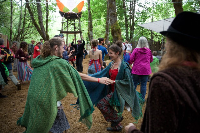 The 18 stages at the fair provide many opportunities for visitors to dance under the canopied woods.